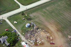 Two days after a tornado hit our area in 2005, I did some aerial sight seeing. The swath of destruction was evident from the air, and this is but one example.