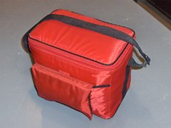 The complete survival kit with the first aid kit tucked into the front.