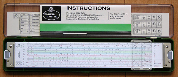 Faber-Castell 2/83N slide rule, case, manual, and reference card.