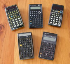An HP 35s (top centre), with an HP-67, HP-34C, HP-41CX, and HP-42S.