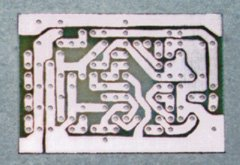 The printed circuit board after etching. The traces aren't as straight as they are in Figure 2 above because they were transferred to the board by hand, using an etch-resist pen.