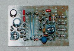 The resistors, diodes, and capacitors (except C8) have been installed.