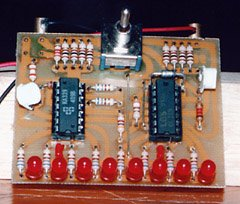 The completed circuit board. The prototype used vertically mounted trimmer potentiometers rather than the more convenient horizontally mounted ones in the parts list. Notice the extra adjusting resistor installed in the R1 group.