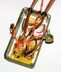 Off-board components are mounted to the case and attached to the board with appropriate gauge wires.