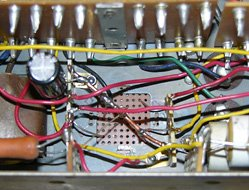 Wiring the silver can capacitor replacements. Notice the copper negative buss, and C66 on the left terminal strip.