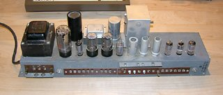 "AO-29 amplifier from my 1962 Hammond M-111, on the workbench, with ""can"" capacitors clearly visible."