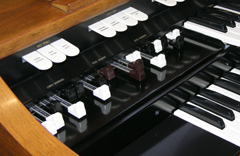 The harmonic drawbars on a Hammond M-111 spinet organ.
