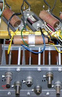 Three tone generator filters from my 1962 Hammond M-111 with wax-paper capacitors. Click image for details.