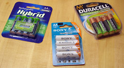 Three popular brands of pre-charged (low self-discharge) rechargeable NiMH AA batteries.