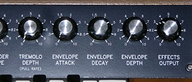 Tremolo depth (first VCA) and envelope attack, decay, and depth (second VCA) controls.