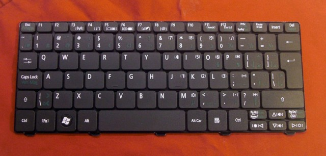 The original keyboard with it's annoying multi-lingual layout.