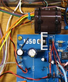 An off-board 5600µF capacitor eliminated the AC hum.
