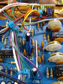 A bundle of wires connects the filter to the main board.