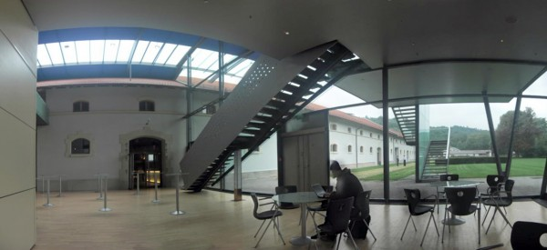 A study/relaxation room just off of the main lecture hall. This image is a panorama assembled from five parts.