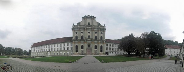 An approximately 180° panoramic photo of the church and monastery, assembled from six separate images.