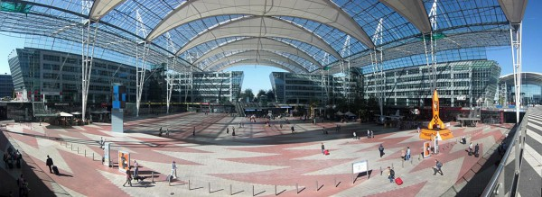 A panorama of the covered courtyard separating terminals 1 and 2 of Munich's Franz Josef Strauss International Airport. Assembled from seven separate photos.