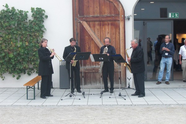 "A short opening concert was performed by  the Abo Sax quartet from the Akademische Blasorchester München (Munich Academic Wind Orchestra). One of the pieces played was Paul McCartney's ""When I'm Sixty-Four"", which I then had running through my head for the entire conference."