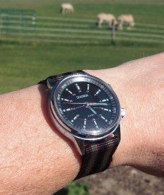 """Out in the real world, on a modified NATO strap in the """"Bond"""" pattern."""