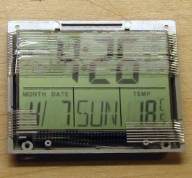 The travel clock was stripped down to fit closer to the dial.