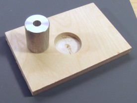 25mm aluminum bushing and wood block with 32mm hole.