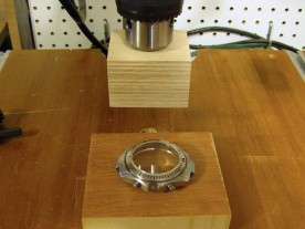 A drill press and some wooden blocks make a suitable press for flat crystals.
