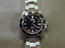 The Invicta's bezel knurling is not quite as fine as the Tudor's.