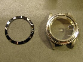 I removed the bezel insert by sliding two knife blades under it, revealing the bezel retaining spring.