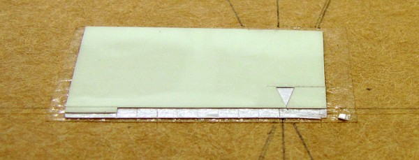 "A small piece of Jessup #7550 lume tape from which I cut the indices for the ""Evolution."""