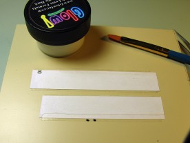 Two strips of adhesive label, and a jar of water-based luminous paint.