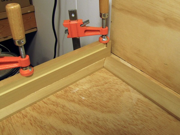 Clamping one of the structural frames to the back of the face frame.