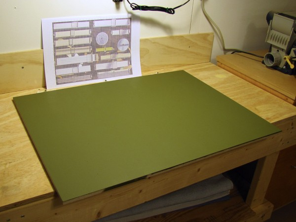 Display board primed and painted with latex wall paint.