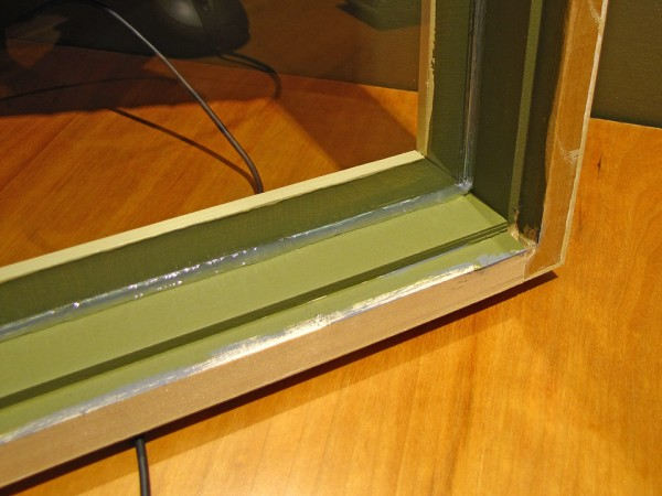 """The glass was cut 1/8"""" undersize, and held in place with clear silicone caulking."""