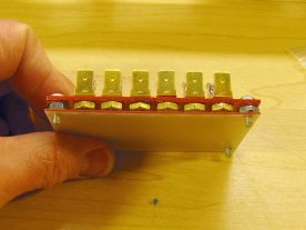 A piece of 1.6mm fibre glass board insulates the fuse holder from the chassis.