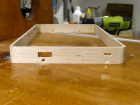 The rectangular holes were finished using a small chisel and files.