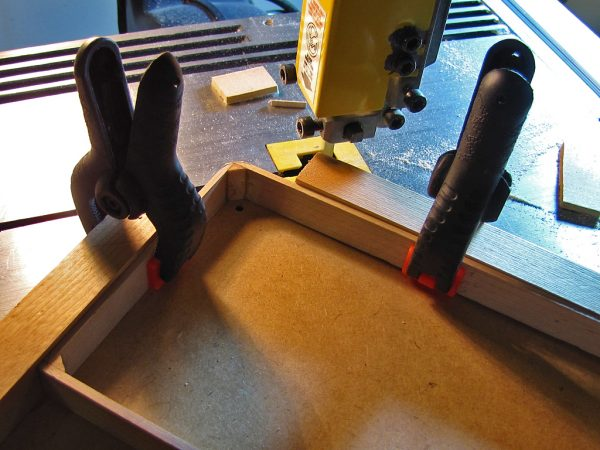 I constructed another jig to hold the frame for rounding the corners, first by cutting them roughly to shape.