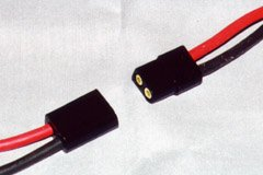 An AstroFlight Zero-Loss connector set, lined up for connection. Notice that one edge is round, and one is square.