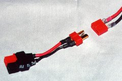 A Deans Ultra Plug connector set, lined up for connection. The object containing the male plug is a Deans-to-Sermos adapter I made for charging my Speed 400 battery packs.