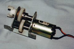 A two stage industrial gearbox. Although this particular gearbox wasn't designed for model aircraft use, the principle of operation is the same. I purchased several of these at a surplus store, and plan to adapt them for e-flight some day (by removing a lot of metal and using hollow shafts, all in the name of saving weight).