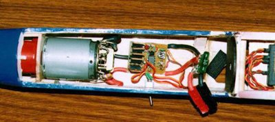 A typical electric power system installation, starting at the front with a folding propeller, gearbox (only partially visible due to the cowling), ferrite motor, high-rate electronic speed control, 30A fuse, and Sermos connectors (hanging over the edge of the fuselage).