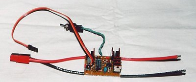 A home made electronic speed control (from the July 1999 issue). On the right are the leads to the motor. The arming switch is on the end of the twisted wires at the top. A pair of Sermos connectors terminates the battery leads.