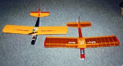 The recipe applies to small models too. These Speed 400 planes draw 10A from 7 cells (70W). Due to the low efficiency of both the motor and propeller, only about 35W of useful power is produced, but that's enough to fly both models well. The one on the left has 1.5 sq.ft of wing; the one on the right has 1.9 sq.ft. Both weigh about 18 oz.