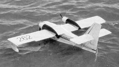 Robert Pike's Canadair CL-215 water bomber uses a pair of Astro 05G geared motors, 10x8 props, and 20 cells. 10x7 props and 21 cells (three 7-cell packs) would also work well. Wing span is 76 inches, area is 800 sq.in, and wing loading is 23 oz/sq.ft.