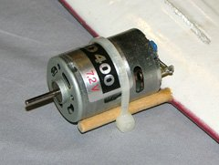 This Speed 400 motor is attached to the dowels with a nylon cable tie. The dowels are set directly into a glassed foam wing.