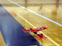 "Taxiing onto the ""runway"" in the college gymnasium with a GWS Pico Stick."