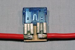 The connectors can be glued to a small scrap of plywood to make a more rigid fuse holder.