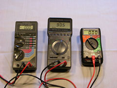 A collection of digital multimeters. The one on left is about 15 years old, while the one on the right is brand new, does all the same things, at a quarter of the cost.