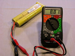 This partially charged 7-cell NiCd battery reads 8.81V, which corresponds to 1.26V per cell. Under load, this voltage would be lower, perhaps 7.7V.