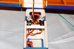 A view into the under-wing area, showing the Hitec HS55 rudder and elevator servos, and the Feather receiver behind them.