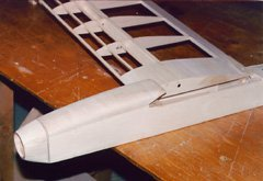 Completed forward fuselage and canopy, with one wing half in place for reference.