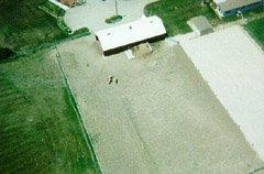 A view of our barn from about 500ft. You can see three Norwegian Fjord horses just below the barn there.